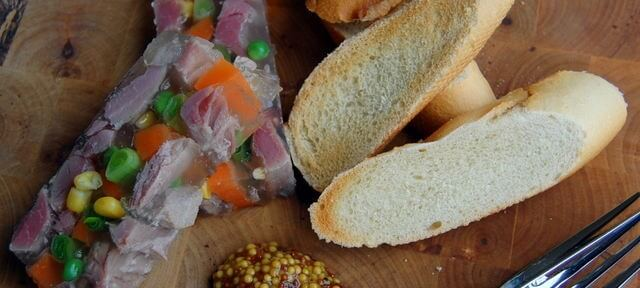 Fresh, chilled ham hock terrine. Perfect for a lazy lunch or a fresh, bright and impressive starter for a dinner party on a budget.